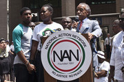 Rev. Al Sharpton speaks as Trayvon Martin's mother Sybrina Fulton and Martin's brother Jahvaris Fulton (L) attend a rally honoring Trayvon Martin organized by the National Action Network outside One Police Plaza in Manhattan on July 20, 2013 in New York City.  Demonstrators have gathered in various cities across the country to protest the acquittal of neighborhood watchman George Zimmerman and press for his federal prosecution in the shooting death of teenager Trayvon Martin.