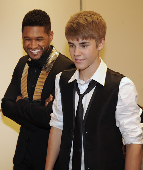 Justin Bieber ****EXECUTIVE COVERAGE**** Justin Bieber and Usher Raymond backstage at the 33rd Annual Georgia Music Hall Of Fame Awards at the Cobb Energy Performing Arts Center on September 17, 2011 in Atlanta, Georgia.