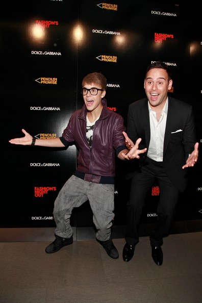 Justin Bieber Singer Justin Bieber and Scooter Braun attend the Dolce & Gabbana Boutique on September 8, 2011 in New York City.
