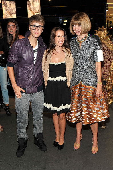 Justin Bieber (L-R) Justin Bieber, Pattie Mallette and Editor-In-Chief of American Vogue, Anna Wintour attend the Dolce & Gabbana celebration during Fashion's Night Out at Dolce & Gabbana Boutique on September 8, 2011 in New York City.