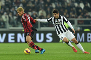 Alvaro Morata (R) of Juventus FC competes with Keisuke Honda of AC Milan during the Serie A match between Juventus FC and AC Milan at Juventus Arena on February 7, 2015 in Turin, Italy.