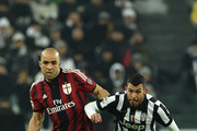 Carlos Tevez (R) of Juventus FC competes with Alex Dias Da Costa of AC Milan during the Serie A match between Juventus FC and AC Milan at Juventus Arena on February 7, 2015 in Turin, Italy.