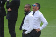 Carlos Tevez and Patrice Evra of Juventus look on while inspecting the pitch at Estadio Santiago Bernabeu ahead of their UEFA Champions League Semi final, Second Leg match against Real Madrid on May 12, 2015 in Madrid, Spain.