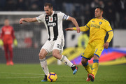 Giorgio Chiellini (L) of Juventus is challenged by Camillo Ciano of Frosinone during the Serie A match between Juventus and Frosinone Calcio on February 15, 2019 in Turin, Italy.