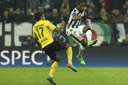 Patrice Evra (R) of Juventus FC competes for the ball with Pierre-Emerick Aubameyang (L) of Borussia Dortmund during the UEFA Champions League Round of 16 match between Juventus and Borussia Dortmund at Juventus Arena on February 24, 2015 in Turin, Italy.