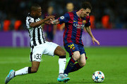 Lionel Messi of Barcelona goes past Patrice Evra of Juventus during the UEFA Champions League Final between Juventus and FC Barcelona at Olympiastadion on June 6, 2015 in Berlin, Germany.