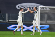 Aaron Ramsey and Leonardo Bonucci of Juventus celebrate their sides victory after the Serie A match between Juventus and Torino FC at Allianz Stadium on December 05, 2020 in Turin, Italy. Football Stadiums around Italy remain empty due to the Coronavirus Pandemic as Government social distancing laws prohibit fans inside venues resulting in fixtures being played behind closed doors.