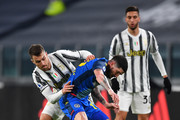Aaron Ramsey of Juventus F.C. tackles Rodrigo De Paul of Udinese Calcio during the Serie A match between Juventus and Udinese Calcio at Allianz Stadium on January 03, 2021 in Turin, Italy. Sporting stadiums around Italy remain under strict restrictions due to the Coronavirus Pandemic as Government social distancing laws prohibit fans inside venues resulting in games being played behind closed doors.