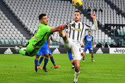 Aaron Ramsey of Juventus F.C. battles for possession with Juan Musso of Udinese Calcio during the Serie A match between Juventus and Udinese Calcio at Allianz Stadium on January 03, 2021 in Turin, Italy. Sporting stadiums around Italy remain under strict restrictions due to the Coronavirus Pandemic as Government social distancing laws prohibit fans inside venues resulting in games being played behind closed doors.