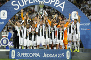 Giorgio Chiellini of Juventus lifts the trophy after winning thethe Italian Supercup match between Juventus and AC Milan at King Abdullah Sports City on January 16, 2019 in Jeddah, Saudi Arabia.