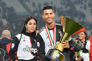 Cristiano Ronaldo (R)  of Juventus celebrates with Georgina Rodriguez during the awards ceremony after winning the Serie A Championship during the Serie A match between Juventus and Atalanta BC on May 19, 2019 in Turin, Italy.