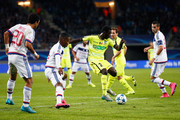 Nana Asare of Gent battles for the ball with Claudio Beauvue, Rafael and Maxime Gonalons of Lyon during the UEFA Champions League Group H match between KAA Gent and Olympique Lyonnais held at Ghelamco Arena on September 16, 2015 in Gent, Belgium.