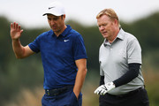 Netherlands football manager, Ronald Koeman (R) speaks with Ross Fisher of England as they walk on the fairway during the ProAm prior to the KLM Open held at The Dutch golf course on September 12, 2018 in Spijk, Netherlands.
