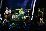 (L-R) Caleb Followill, Nathan Followill, Matthew Followill and Jared Followill of the band Kings of Leon perform onstage at 106.7 KROQ Almost Acoustic Christmas 2016 - Night 1 at The Forum on December 10, 2016 in Inglewood, California.