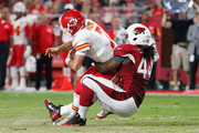 Outside linebacker Markus Golden #44 of the Arizona Cardinals sacks quarterback Aaron Murray #7 of the Kansas City Chiefs during the pre-season NFL game at the University of Phoenix Stadium on August 15, 2015 in Glendale, Arizona. The Chiefs defeated the Cardinals 34-19.