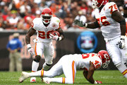 Running back Thomas Jones #20 of the Kansas City Chiefs gets a block from Tim Castille #46 and Branden Albert #76 against the Cleveland Browns at Cleveland Browns Stadium on September 19, 2010 in Cleveland, Ohio.