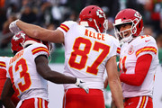 Travis Kelce #87 of the Kansas City Chiefs celebrates with  De'Anthony Thomas #13 of the Kansas City Chiefs and Alex Smith #11 of the Kansas City Chiefs after scoring a touchdown during their game at MetLife Stadium on December 3, 2017 in East Rutherford, New Jersey.