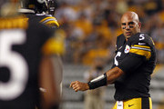 Bruce Gradkowski #5 of the Pittsburgh Steelers gets up after having his helmet ripped off against the Kansas City Chiefs in the second half during the game on August 24, 2013 at Heinz Field in Pittsburgh, Pennsylvania.