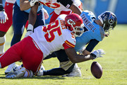 Chris Jones #95 of the Kansas City Chiefs sacks Ryan Tannehill #17 of the Tennessee Titans, causing a fumble in the first half at Nissan Stadium on November 10, 2019 in Nashville, Tennessee.