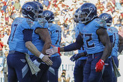 Derrick Henry #22 of the Tennessee Titans is congratulated by teammate Ryan Tannehill #17 after scoring a touchdown against the Kansas City Chiefs during the second half at Nissan Stadium on November 10, 2019 in Nashville, Tennessee.