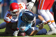 Quarterback Ryan Tannehill #17 of the Tennessee Titans is hit by defensive end Chris Jones #95 of the Kansas City Chiefs as he forces the fumble in the first quarter at Nissan Stadium on November 10, 2019 in Nashville, Tennessee.