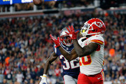 Tyreek Hill #10 of the Kansas City Chiefs catches a touchdown pass against the defense of Devin McCourty #32 of the New England Patriots in the third quarter at Gillette Stadium on October 14, 2018 in Foxborough, Massachusetts.