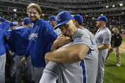 Raul Ibanez #18 of the Kansas City Royals (R) hugs Jarrod Dyson #1 after they defeated the Chicago White Sox to clinch a Wild Card berth at U.S. Cellular Field on September 26, 2014 in Chicago, Illinois. The Royals defeated the White Sox 3-1.