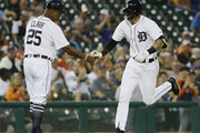 Nicholas Castellanos #9 of the Detroit Tigers is congratulated by third base coach Dave Clark #25 of the Detroit Tigers after hitting a solo home run against the Kansas City Royals during the first inning at Comerica Park on September 20, 2018 in Detroit, Michigan. The Tigers defeated the Royals 11-8.
