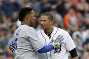 Victor Martinez #41 of the Detroit Tigers is congratulated by Salvador Perez #13 of the Kansas City Royals as Martinez leaves the game for a pinch hitter after hitting a single during the first inning at Comerica Park on September 22, 2018 in Detroit, Michigan. Martinez had announced that he was retiring at Saturday's game.