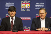 Right-handed pitcher Lance McCullers (L) who was selected in the compensation first round (41st overall) of the 2012 MLB First Year Player Draft, is introduced during a press conference with his agent Scott Boras at Minute Maid Park on June 18, 2012 in Houston, Texas.