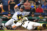 Francisco Cervelli #29 of the Pittsburgh Pirates tags out Salvador Perez #13 of the Kansas City Royals during the ninth inning at PNC Park on September 18, 2018 in Pittsburgh, Pennsylvania.