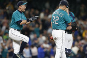 Ichiro Suzuki #51 of the Seattle Mariners jokes with Marco Gonzales #32 and Mike Zunino #3, back, after Gonzales pitched his first complete game against the Kansas City Royals at Safeco Field on June 29, 2018 in Seattle, Washington. The Seattle Mariners beat the Kansas City Royals 4-1.
