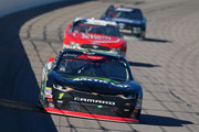 Elliott Sadler, driver of the #1 Textron Off Road Wildcat XX Chevrolet, leads a pack of cars during the NASCAR Xfinity Series Kansas Lottery 300 at Kansas Speedway on October 20, 2018 in Kansas City, Kansas.