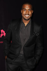 Adding some pizazz to his look, Kanye spiced up his all black look with a polka dot pocket scarf.
