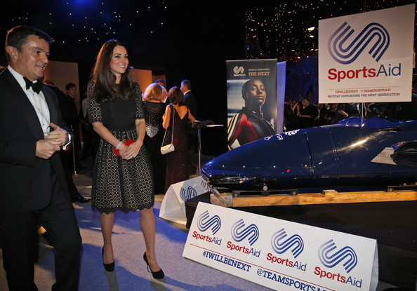 Kate Middleton Catherine, Duchess of Cambridge, patron of SportsAid charity, walks with Tim Lawler, the chief executive of the charity, as she attends the SportsBall, the charity's annual gala dinner at Victoria Embankment Gardens on November 28, 2013  in London, England.