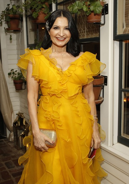 2020 Netflix Oscar After Party [yellow,clothing,shoulder,dress,lady,fashion model,cocktail dress,hairstyle,fashion,beauty,oscar,kathrine narducci,san vicente bugalows,west hollywood,california,netflix,party,kathrine narducci,photography,fashion show,getty images,livingly media,fashion,image,stock photography,celebrity]