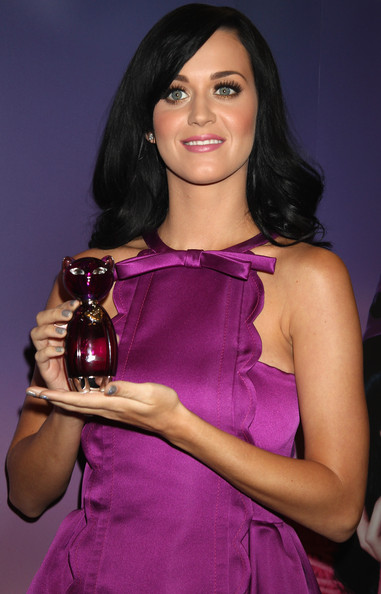 Katy Perry Singer Katy Perry poses at the launch of her new fragrance 'Purr' at Selfridges on November 12, 2010 in London, England.