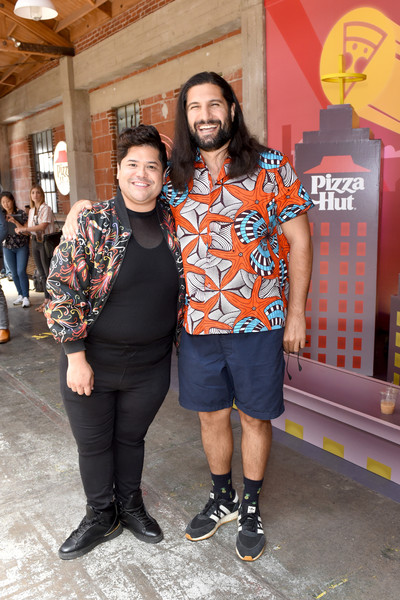 Pizza Hut Lounge At 2019 Comic-Con International: San Diego [what we do in the shadows,fashion,footwear,event,style,t-shirt,harvey guillen,kayvan novak,l-r,pizza hut lounge,san diego,california,comic-con international: san diego]