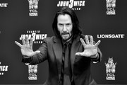Image has been converted to black and white) Keanu Reeves attends 'Keanu Reeves places his hand prints in cement' at TCL Chinese Theatre IMAX on May 14, 2019 in Hollywood, California.