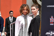 Halle Berry (L) and Asia Kate Dillon attend a handprint ceremony honoring Keanu Reeves at the TCL Chinese Theatre IMAX forecourt on May 14, 2019 in Hollywood, California.