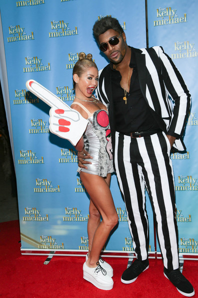 Kelly Ripa and Michael Strahan Celebrate Halloween [live with kelly and michael,image,photograph,flooring,carpet,product,event,red carpet,advertising,shoe,fun,kelly ripa,michael strahan,costume,halloween costume,live with kelly and michael studio,new york city,best halloween show,kelly ripa,miley cyrus,live with kelly and ryan,celebrity,costume,halloween,halloween costume,image,photograph,go fug yourself]