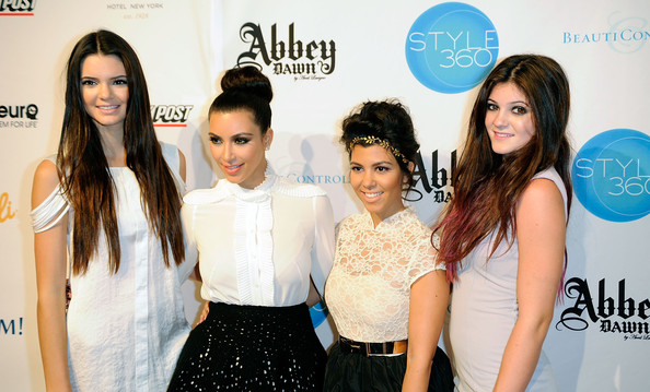 Kendall Jenner (L-R) Kendall Jenner, Kim Kardashian, Kourtney Kardashian, and Kylie Jenner attend the Abbey Dawn by Avril Lavigne Spring 2012 fashion show during Style360 at the Metropolitan Pavilion on September 12, 2011 in New York City.