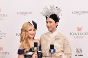 American figure skaters Tara Lipinski and Johnny Weir attend Kentucky Derby 144 on May 5, 2018 in Louisville, Kentucky.