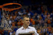 Head coach Billy Donovan of the Florida Gators prepares to cut off a piece of the net after the game against the Kentucky Wildcats at the Stephen C. O'Connell Center on March 8, 2014 in Gainesville, Florida. The Gators were 18-0 in the SEC Conference and undefeated at home this season.