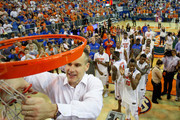 Head coach Billy Donovan of the Florida Gators cuts off a piece of the net after the game against the Kentucky Wildcats at the Stephen C. O'Connell Center on March 8, 2014 in Gainesville, Florida. The Gators were 18-0 in the SEC Confrence and undefeated at home this season.