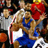 Andrew Harrison Photos - Andrew Harrison #5 of the Kentucky Wildcats draws a foul as he grabs a loose ball against Marcus Thornton #2 and Kenny Gaines #12 of the Georgia Bulldogs at Stegeman Coliseum on March 3, 2015 in Athens, Georgia. - Kentucky v Georgia