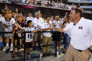 Head coach Dan Mullen of the Mississippi State Bulldogs greets fans after they defeated the Kentucky Wildcats 45-7 in an NCAA football game at Davis Wade Stadium on October 21, 2017 in Starkville, Mississippi.