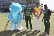 Official mascot 'Stumpy' (L) Shahid Afridi (2L) captain of Pakistan,Pepsi Winner (2R) and Jimmy Kamande (R) captain of Kenyaduring the Kenya v Pakistan 2011 ICC World Cup Group A match at the Mahinda Rajapaksa International Cricket Stadium on February 23, 2011 in Hambantota, Sri Lanka.
