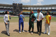 "Kumar Sangakkara (""L) captain of Sri Lanka spins the coin watched by Jimmy Kamande (£L) captain of Kenya,Chris Broad (2R) ICC match referee and Pepsi winner (R) during the Kenya v Sri Lanka 2011 ICC World Cup Group A match at the R. Premadasa Stadium on March 1, 2011 in Colombo, Sri Lanka."