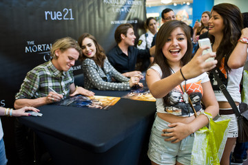 Kevin Zegers Jamie Campbell Bower Lily Collins, Jamie Campbell Bower, And Kevin Zegers Of THE MORTAL INSTRUMENTS In Chicago